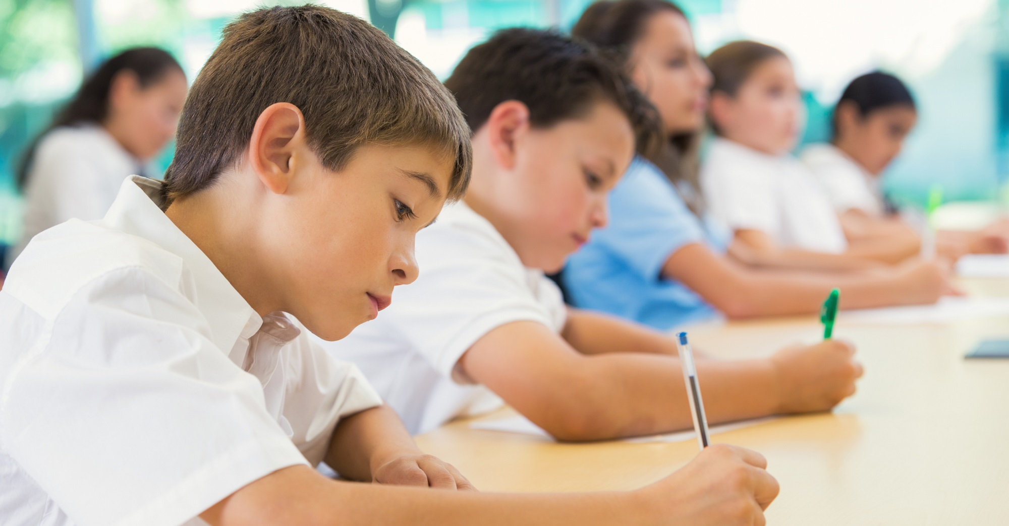 Diverse students taking test in private elementary school